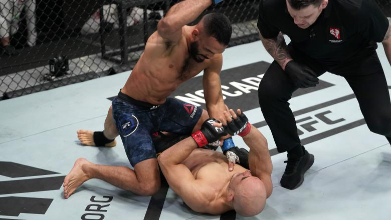 Rob Font punches Marlon Moraes of Brazil in a bantamweight fight during the UFC Fight Night event at UFC APEX on December 19, 2020 in Las Vegas, Nevada. (Photo by Cooper Neill/Zuffa LLC)