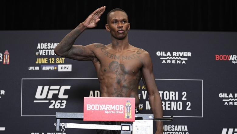 Israel Adesanya of Nigeria poses on the scale during the UFC 263 official weigh-in on June 11, 2021 in Phoenix, Arizona. (Photo by Jeff Bottari/Zuffa LLC)