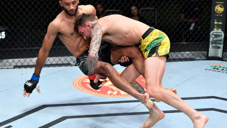 Renato Moicano of Brazil takes down Jai Herbert of England in a lightweight fight during the UFC Fight Night event at UFC APEX on June 26, 2021 in Las Vegas, Nevada. (Photo by Chris Unger/Zuffa LLC)