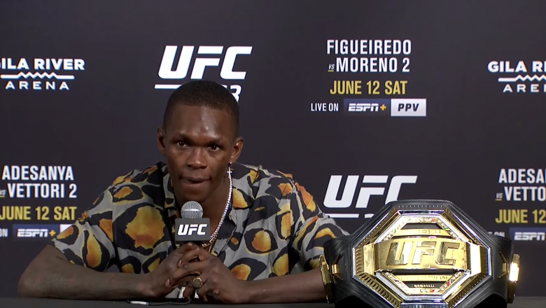 Israel Adesanya talks with the media after defeating Marvin Vettori at UFC 263.