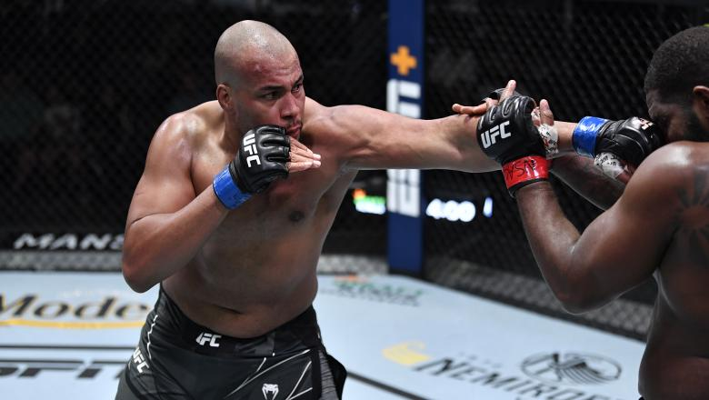Rodrigo Nascimento of Brazil punches Alan Baudot of France in their heavyweight bout during the UFC Fight Night event at UFC APEX on July 17, 2021 in Las Vegas, Nevada. (Photo by Jeff Bottari/Zuffa LLC)