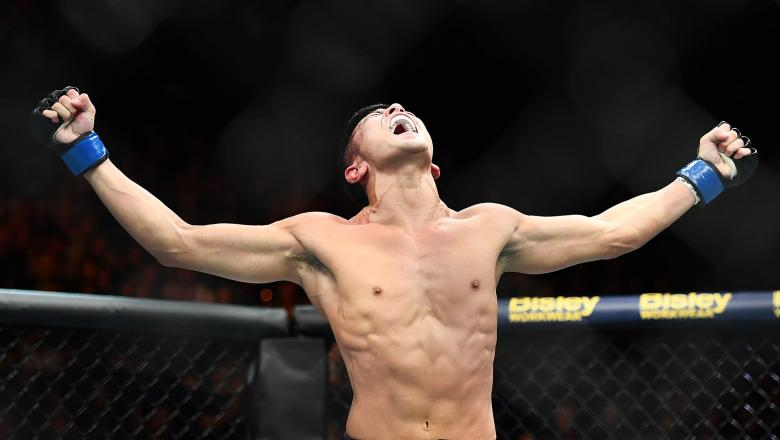 Kyung Ho Kang celebrates winning his fight against Teruto Ishihara in their Bantamweight fight during UFC234 at Rod Laver Arena on February 10 2019 in Melbourne, Australia. (Photo by Quinn Rooney/Getty Images)