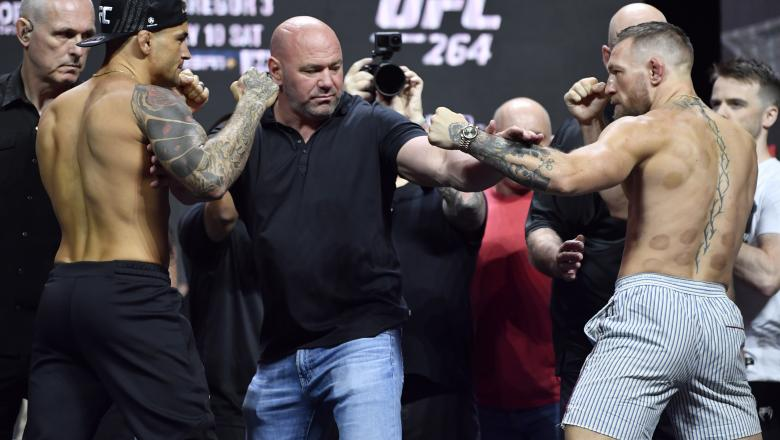 Dustin Poirier and Conor McGregor of Ireland face off during the UFC 264 ceremonial weigh-in at T-Mobile Arena on July 09, 2021 in Las Vegas, Nevada. (Photo by Jeff Bottari/Zuffa LLC)