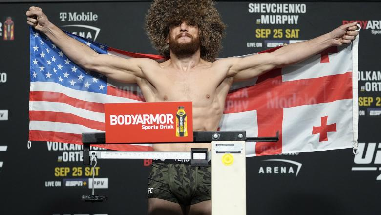 Merab Dvalishvili of Georgia poses on the scale during the UFC 266 official weigh-in at UFC APEX on September 24, 2021 in Las Vegas, Nevada. (Photo by Jeff Bottari/Zuffa LLC)