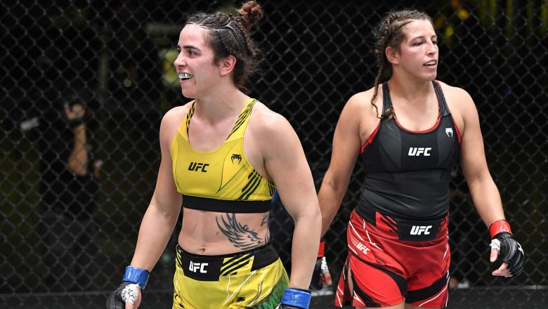 Norma Dumont Viana of Brazil and Felicia Spencer of Canada react after finishing three rounds in their women's featherweight bout during the UFC Fight Night event at UFC APEX on May 22 2021 in Las Vegas Nevada. (Photo by Chris Unger/Zuffa LLC)