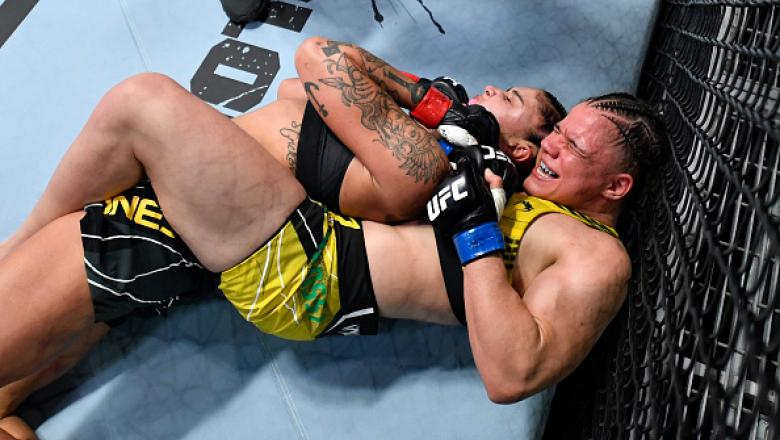 Ariane Carnelossi of Brazil secures a rear choke submission against Istela Nunes of Brazil in a strawweight fight during the UFC Fight Night event at UFC APEX on October 16 2021 in Las Vegas Nevada. (Photo by Chris Unger/Zuffa LLC)