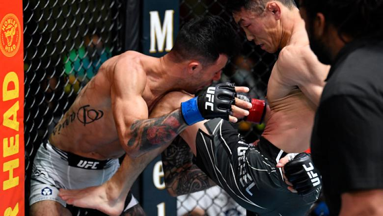 Danaa Batgerel of Mongolia knees Brandon Davis in a bantamweight fight during the UFC Fight Night event at UFC APEX on October 16 2021 in Las Vegas Nevada. (Photo by Chris Unger/Zuffa LLC)