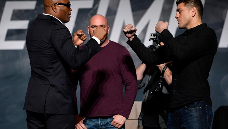 LAS VEGAS, NEVADA - NOVEMBER 17:  Anderson Silva (L) and Nick Diaz face off during the UFC Time Is Now press conference at The Smith Center for the Performing Arts on November 17, 2014 in Las Vegas, Nevada. (Photo by Jeff Bottari/Zuffa LLC/Zuffa LLC via G
