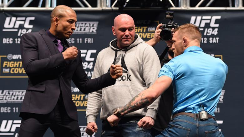 LAS VEGAS, NV - DECEMBER 09:  (L-R) Opponents Jose Aldo of Brazil and Conor McGregor of Ireland face off during the UFC Press Conference inside MGM Grand Garden Arena on December 9, 2015 in Las Vegas, Nevada.  (Photo by Josh Hedges/Zuffa LLC/Zuffa LLC via