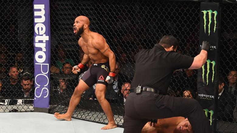 LAS VEGAS, NV - APRIL 23:  Demetrious Johnson celebrates his TKO victory over Henry Cejudo in their flyweight championship bout during the UFC 197 event inside MGM Grand Garden Arena on April 23, 2016 in Las Vegas, Nevada.  (Photo by Josh Hedges/Zuffa LLC