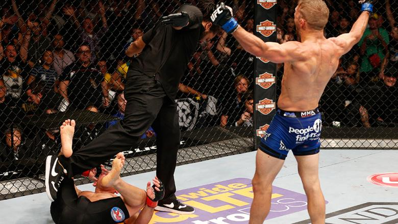 LAS VEGAS, NV - MAY 24:  T.J. Dillashaw (right) reacts to his victory over Renan Barao in their bantamweight championship bout during the UFC 173 event at the MGM Grand Garden Arena on May 24, 2014 in Las Vegas, Nevada. (Photo by Josh Hedges/Zuffa LLC/Zuf