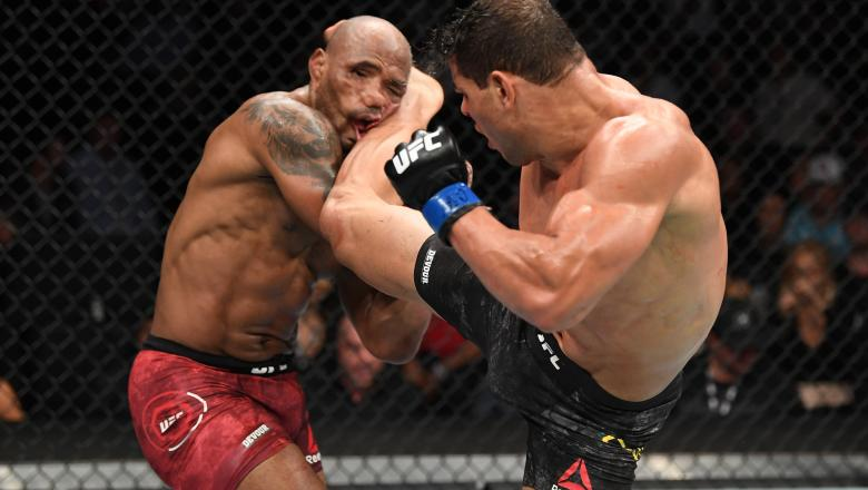 Paulo Costa of Brazil kicks Yoel Romero of Cuba in their middleweight bout during the UFC 241