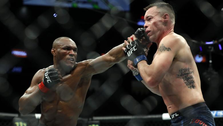 Colby Covington rests against the Octagon fence after losing a title fight against UFC welterweight champion Kamaru Usman during UFC 245