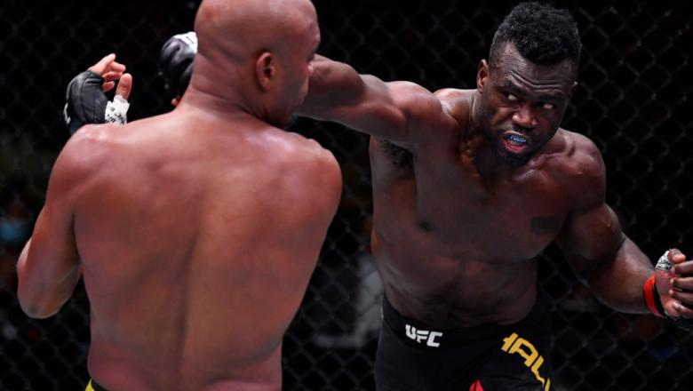 LAS VEGAS, NEVADA - OCTOBER 31: (R-L) Uriah Hall of Jamaica punches Anderson Silva of Brazil in a middleweight bout