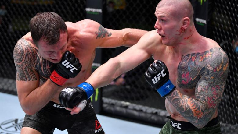 LAS VEGAS, NEVADA - DECEMBER 05: (R-L) Marvin Vettori of Italy punches Jack Hermansson of Sweden in a middleweight bout during the UFC Fight Night