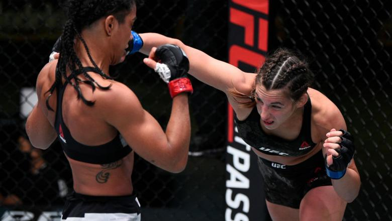 LAS VEGAS, NEVADA - SEPTEMBER 05: In this handout image provided by UFC, (R-L) Montana De La Rosa punches Viviane Araujo of Brazil in a flyweight fight during the UFC Fight Night