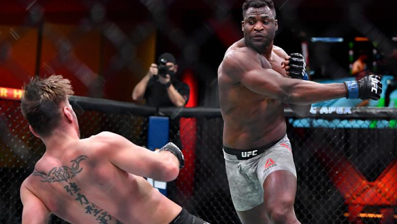 Francis Ngannou of Cameroon drops Stipe Miocic in their UFC heavyweight championship fight during the UFC 260 event at UFC APEX
