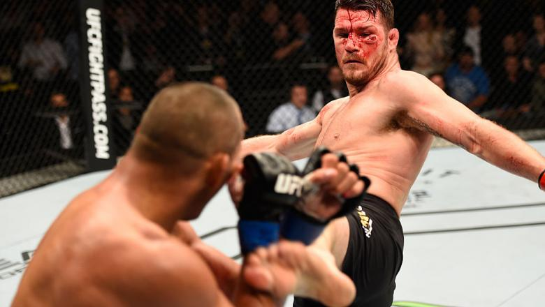 MANCHESTER, ENGLAND - OCTOBER 08:  (R-L) Michael Bisping of England kicks Dan Henderson in their UFC middleweight championship bout during the UFC 204 Fight Night at the Manchester Evening News Arena on October 8, 2016 in Manchester, England. (Photo by Jo
