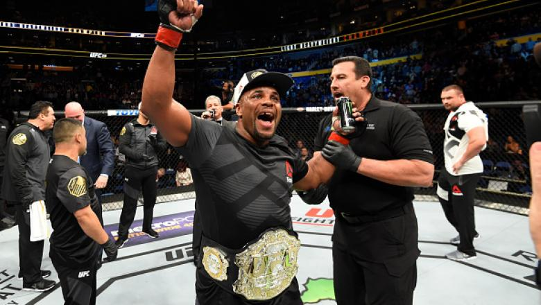 BUFFALO, NY - APRIL 08: Daniel Cormier celebrates his rear choke submission victory over Anthony Johnson in their UFC light heavyweight championship bout during the UFC 210 event at KeyBank Center on April 8, 2017 in Buffalo, New York.  (Photo by Josh Hed