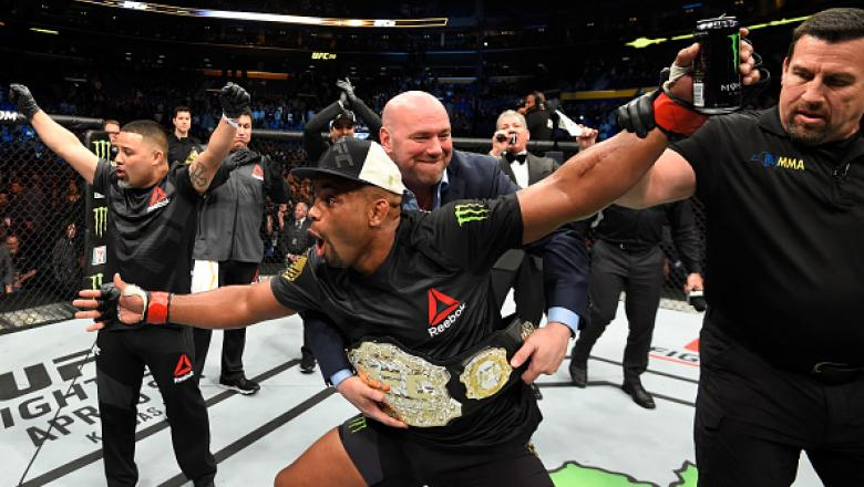 BUFFALO, NY - APRIL 08:  Daniel Cormier celebrates his rear choke submission victory over Anthony Johnson in their UFC light heavyweight championship bout during the UFC 210 event at KeyBank Center on April 8, 2017 in Buffalo, New York.  (Photo by Josh He