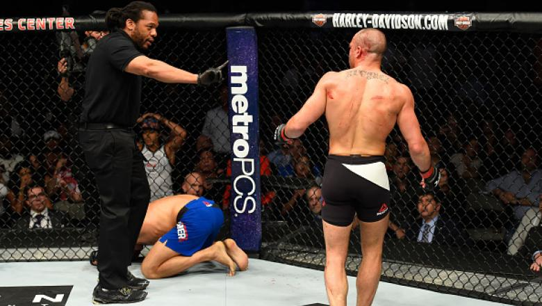 DALLAS, TX - MAY 13:  (R-L) Eddie Alvarez is told to go to his corner after an illegal knee Dustin Poirier in their lightweight fight during the UFC 211 event at the American Airlines Center on May 13, 2017 in Dallas, Texas. (Photo by Josh Hedges/Zuffa LL