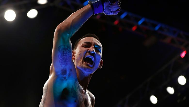 RIO DE JANEIRO, BRAZIL - JUNE 03:  Max Holloway celebrates after his TKO victory over Jose Aldo of Brazil in their UFC featherweight championship bout during the UFC 212 event at Jeunesse Arena on June 3, 2017 in Rio de Janeiro, Brazil. (Photo by Buda Men