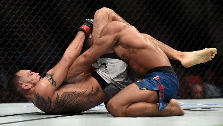 LAS VEGAS, NV - OCTOBER 07:   Tony Ferguson secures a triangle choke submission to defeat Kevin Lee in their interim UFC lightweight championship bout during the UFC 216 event inside T-Mobile Arena on October 7, 2017 in Las Vegas, Nevada. (Photo by Brando