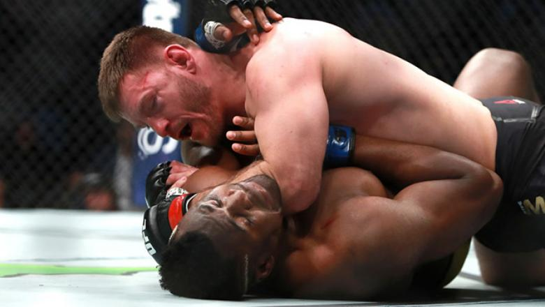 BOSTON, MA - JANUARY 20:  Stipe Miocic grapples with Francis Ngannou in their Heavyweight Championship fight during UFC 220 at TD Garden on January 20, 2018 in Boston, Massachusetts.  (Photo by Mike Lawrie/Getty Images)