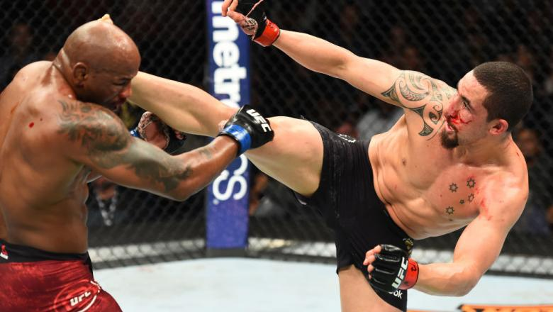 CHICAGO, ILLINOIS - JUNE 09:  (R-L) Robert Whittaker of New Zealand lands a kick to the head of Yoel Romero of Cuba in their middleweight fight during the UFC 225 event at the United Center on June 9, 2018 in Chicago, Illinois. (Photo by Josh Hedges/Zuffa