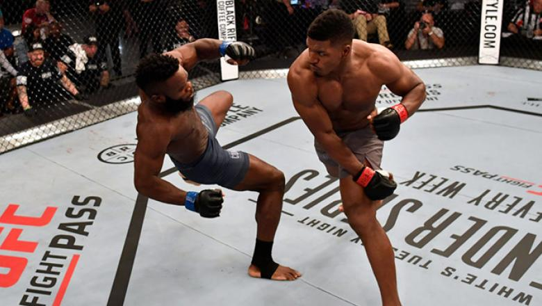 LAS VEGAS, NV - JUNE 12:  (R-L) Alonzo Menifield punches Dashawn Boatwright in their light heavyweight bout during Dana White's Tuesday Night Contender Series at the TUF Gym on June 12, 2018 in Las Vegas, Nevada. (Photo by Jeff Bottari/DWTNCS LLC)