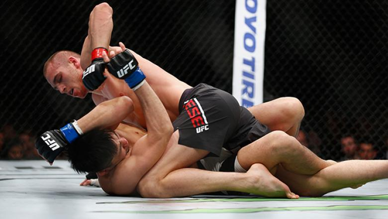 LONDON, ENGLAND - FEBRUARY 27: Tom Breese of England in action as he beats Keita Nakamura of Japan during the Welterweight Bout of the UFC Fight Night at The O2 Arena on February 27, 2016 in London, England. (Photo by Christopher Lee/Getty Images)
