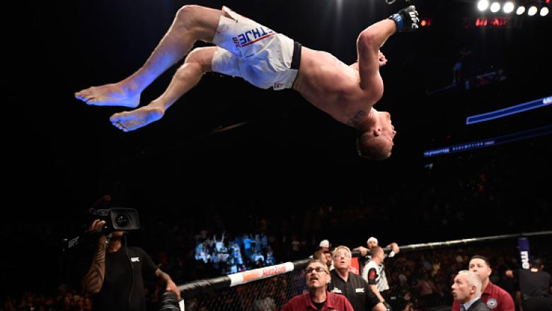 Justin Gaethje celebrates by doing a backflip off the Octagon after defeating Michael Johnson in their lightweight bout during The Ultimate Fighter Finale in 2017