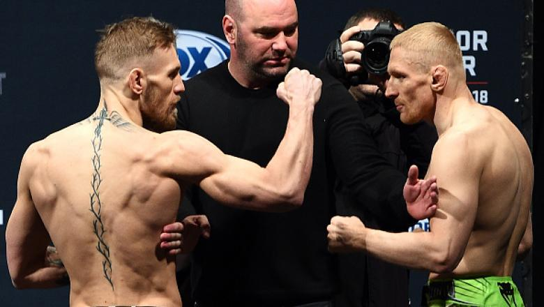 BOSTON, MA - JANUARY 17:  UFC featherweights Conor 'The Notorious' McGregor of Ireland (L) faces off with opponent Dennis Siver of Germany during the UFC Fight Night Boston weigh-in event at the Orpheum Theatre on January 17, 2015 in Boston, Massachusetts