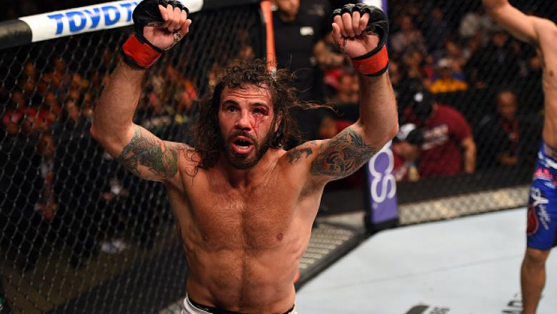 FAIRFAX, VA - APRIL 04:   Clay Guida celebrates after defeating Robbie Peralta in their featherweight fight during the UFC Fight Night event at the Patriot Center on April 4, 2015 in Fairfax, Virginia. (Photo by Josh Hedges/Zuffa LLC/Zuffa LLC via Getty I