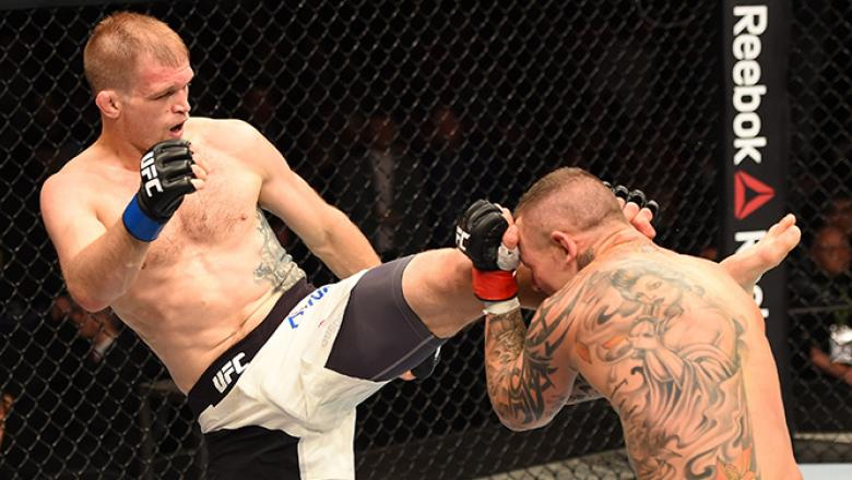 (L-R) Evan Dunham of the United States kicks Ross Pearson of England in their lightweight fight during the UFC Fight Night event inside the SSE Hydro on July 18, 2015 in Glasgow, Scotland.  (Photo by Josh Hedges/Zuffa LLC/Zuffa LLC via Getty Images)