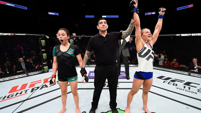 HOUSTON, TX - FEBRUARY 04:  (R-L) Felice Herrig celebrates her victory over Alexa Grasso of Mexico in their women's strawweight bout during the UFC Fight Night event at the Toyota Center on February 4, 2017 in Houston, Texas. (Photo by Jeff Bottari/Zuffa