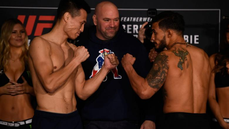 HOUSTON, TEXAS - FEBRUARY 03:  (L-R) Opponents Chan Sung Jung of South Korea and Dennis Bermudez face off during the UFC Fight Night weigh-in at the Sheraton North Houston at George Bush Intercontinental on February 3, 2017 in Houston, Texas. (Photo by Je