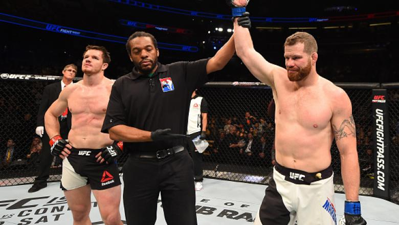 ORLANDO, FL - DECEMBER 19:   (R-L) Nate Marquardt celebrates his knockout victory over CB Dollaway in their middleweight bout during the UFC Fight Night event at the Amway Center on December 19, 2015 in Orlando, Florida. (Photo by Josh Hedges/Zuffa LLC/Zu