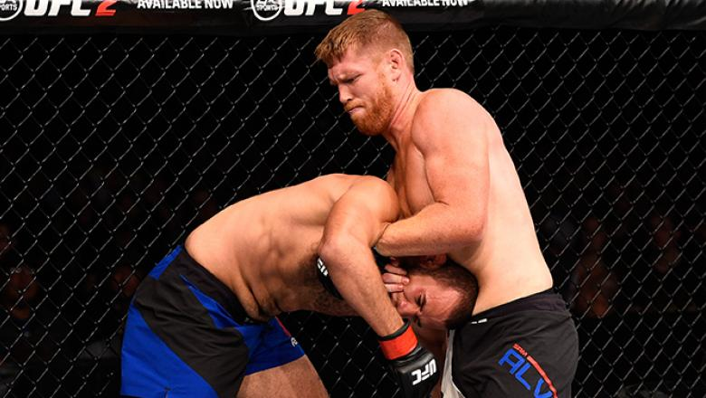 JULY 13: (R-L) Sam Alvey secures a guillotine choke submission against Eric Spicely in their middleweight bout during the UFC Fight Night event on July 13, 2016 at Denny Sanford Premier Center in Sioux Falls, South Dakota. (Photo by Jeff Bottari/Zuffa LLC