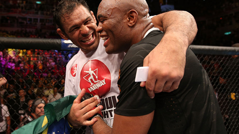 "RIO DE JANEIRO, BRAZIL - OCTOBER 13:  (R-L) Anderson Silva and his teammate Antonio Rodrigo ""Minotauro"" Nogeuira celebrate after Silva's victory over Stephan Bonnar during their light heavyweight fight at UFC 153 inside HSBC Arena on October 13, 2012 in R"