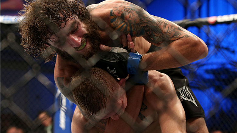 FORT CAMPBELL, KENTUCKY - NOVEMBER 6:  Michael Chiesa (top) attempts to submit Colton Smith in their UFC lightweight bout on November 6, 2013 in Fort Campbell, Kentucky. (Photo by Ed Mulholland/Zuffa LLC/Zuffa LLC via Getty Images) *** Local Caption ***Co