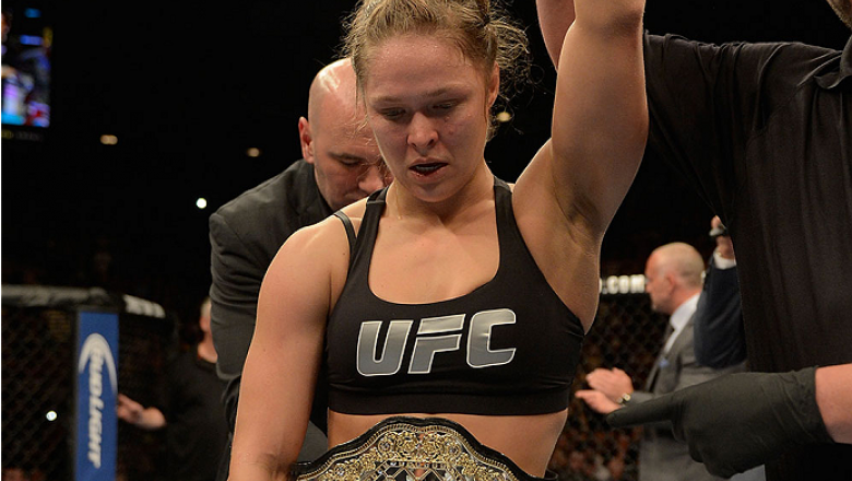 LAS VEGAS, NV - DECEMBER 28:  Ronda Rousey reacts to her victory over Miesha Tate in their UFC women's bantamweight championship bout during the UFC 168 event at the MGM Grand Garden Arena on December 28, 2013 in Las Vegas, Nevada. (Photo by Donald Mirall