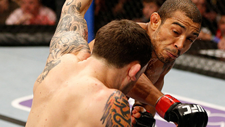 LAS VEGAS, NV - FEBRUARY 02:  Jose Aldo (right) punches Frankie Edgar during their featherweight title fight at UFC 156 on February 2, 2013 at the Mandalay Bay Events Center in Las Vegas, Nevada.  (Photo by Josh Hedges/Zuffa LLC/Zuffa LLC via Getty Images