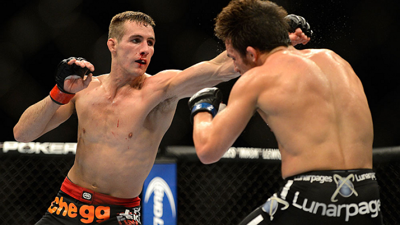 SEATTLE, WA - JULY 27: (L-R) Rory MacDonald punches Jake Ellenberger in their welterweight bout during the UFC on FOX event at Key Arena on July 27, 2013 in Seattle, Washington. (Photo by Jeff Bottari/Zuffa LLC/Zuffa LLC via Getty Images) *** Local Captio