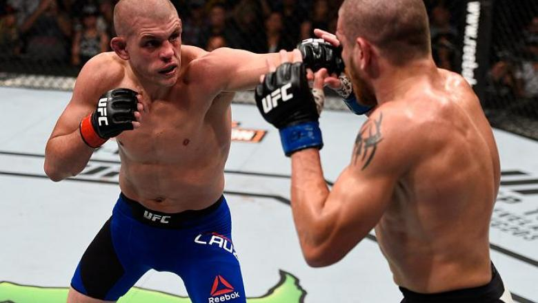 VANCOUVER, BC - AUGUST 27:  (L-R) Joe Lauzon of the United States punches Jim Miller of the United States in their lightweight bout during the UFC Fight Night event at Rogers Arena on August 27, 2016 in Vancouver, British Columbia, Canada. (Photo by Jeff
