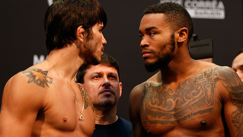 BARUERI, BRAZIL - DECEMBER 19:  (L-R) Opponents Erick Silva of Brazil and Mike Rhodes of the United States face off during the UFC weigh-in event inside the Ginasio Jose Correa on December 19, 2014 in Barueri, Brazil. (Photo by Josh Hedges/Zuffa LLC/Zuffa