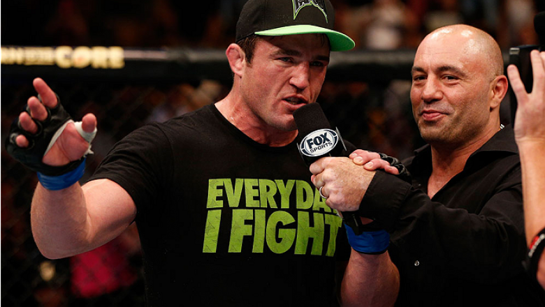 """BOSTON, MA - AUGUST 17:  Chael Sonnen is interviewed by Joe Rogan after his submission victory over Mauricio """"Shogun"""" Rua in their UFC light heavyweight bout at TD Garden on August 17, 2013 in Boston, Massachusetts. (Photo by Josh Hedges/Zuffa LLC/Zuffa L"""