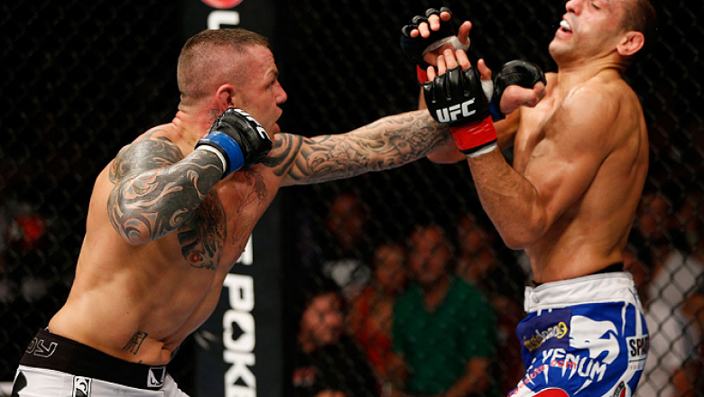 GOLD COAST, AUSTRALIA - DECEMBER 15:  (L-R) Ross Pearson punches George Sotiropoulos during their lightweight fight at the UFC on FX event on December 15, 2012  at Gold Coast Convention and Exhibition Centre in Gold Coast, Australia.  (Photo by Josh Hedge