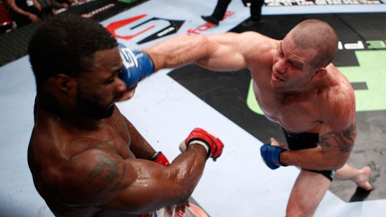 PORTLAND, OR - JULY 14:   (R-L) Nate Marquardt punches Tyron Woodley during their welterweight bout at the Strikeforce event at the Rose Garden on July 14, 2012 in Portland, Oregon.  (Photo by Esther Lin/Forza LLC/Zuffa LLC via Getty Images)  *** Local Ca