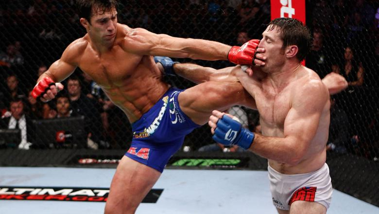 PORTLAND, OR - JULY 14:   (L-R) Luke Rockhold kicks Tim Kennedy during their middleweight championship bout at the Strikeforce event at the Rose Garden on July 14, 2012 in Portland, Oregon.  (Photo by Esther Lin/Forza LLC/Zuffa LLC via Getty Images)  ***
